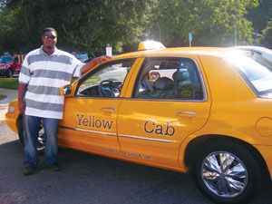 "Before going to work as a nursing assistant at the University of Virginia Medical Center, Jesse ""LJ"" Matthew drove a taxi in Charlottesville for many years. He's shown here with his Yellow Cab in 2007."