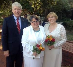 Attorney General Mark Herring and Plaintiffs Carol Schall and Mary Townley celebrate.