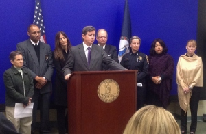 Lynchburg prosecutor Michael Doucette at podium, Gil Harrington is far right