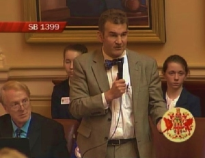 Senator Chap Peterson argues against the bill.