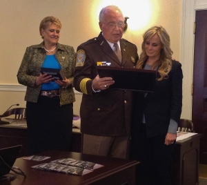 Bedford County Sheriff Mike Brown presents plaque to Tammy Garcia.