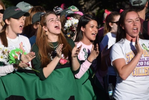 "Students sing the ""Holla Holla"" song atop Monument Hill on Sunday. Photo by Hawes Spencer."
